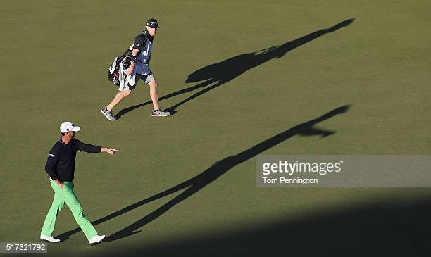Scott Piercy of the United States walks with his caddie across the 16th green during the second round of the World Golf ChampionshipsDell Match Play...