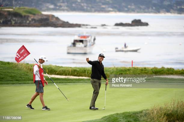 Scott Piercy of the United States waves to the crowd on the 17th green during the first round of the 2019 US Open at Pebble Beach Golf Links on June...
