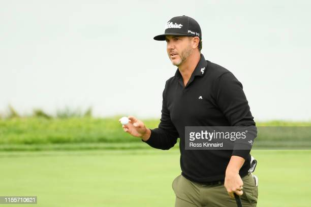 Scott Piercy of the United States waves to the crowd on the tenth green during the first round of the 2019 US Open at Pebble Beach Golf Links on June...