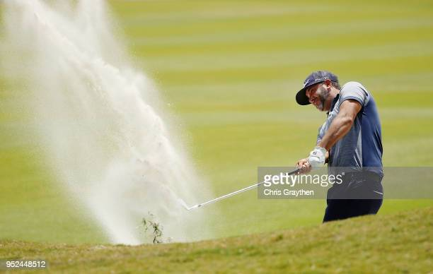 Scott Piercy plays a shot from a bunker on the 18th hole during the third round of the Zurich Classic at TPC Louisiana on April 28 2018 in Avondale...