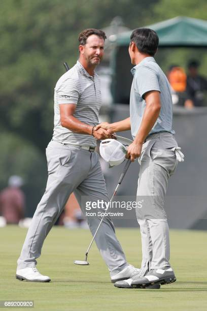 Scott Piercy shakes hands with Danny Lee of New Zealand after the third round of the PGA Dean Deluca Invitational on May 27 2017 at Colonial Country...