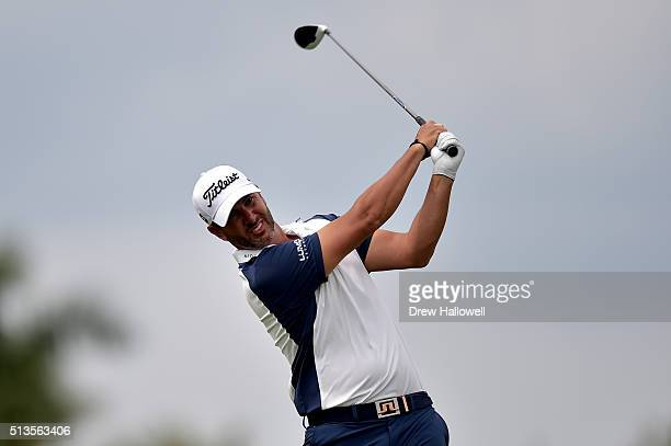 Scott Piercy tees off on the 11th hole during the first round of the World Golf ChampionshipsCadillac Championship at Trump National Doral Blue...