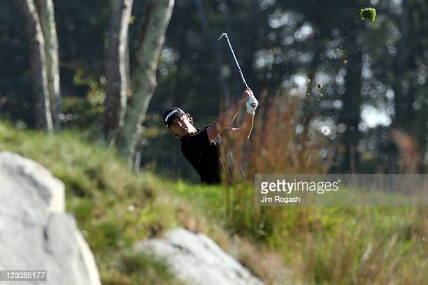 Scott Piercy watches his approach shot from the fairway on the 17th hole during the first round of the Deutsche Bank Championship at TPC Boston on...