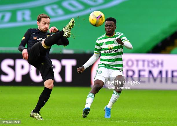 Scott Pittman of Livingston FC clears the ball under pressure form Ismaila Soro of Celtic during the Ladbrokes Scottish Premiership match between...