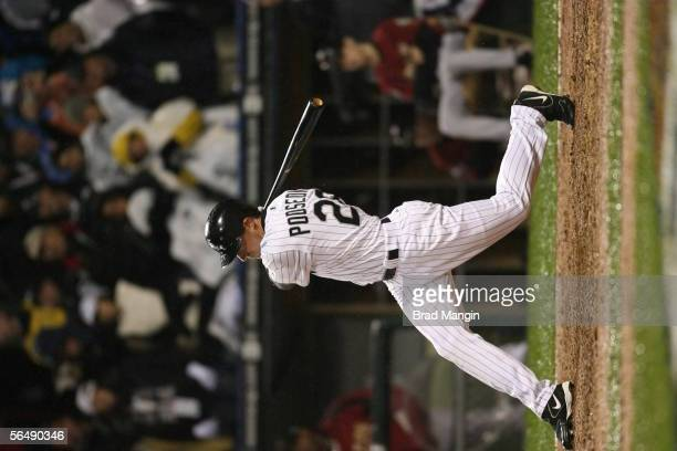 Scott Podsednik of the Chicago White Sox hits a game winning home run off of Brad Lidge during the bottom of the ninth inning of Game Two of the...