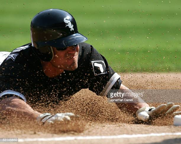 Scott Podsednik of the Chicago White Sox slides into third base in the third inning against the Chicago Cubs for his 38th stolen base of the season...