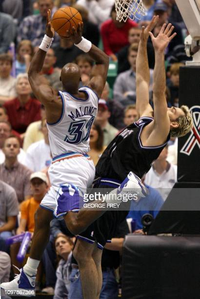 Scott Pollard of the Sacramento Kings fouls Karl Malone of the Utah Jazz as he shoots the ball during the fourth quarter of game 3 of the first round...