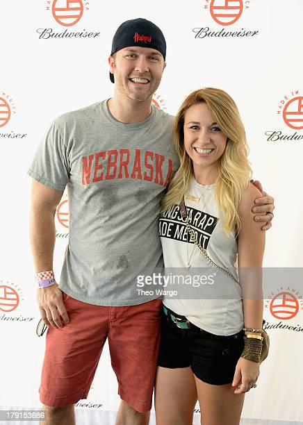 Scott Porter and Kelsey Porter pose backstage during the 2013 Budweiser Made In America Festival at Benjamin Franklin Parkway on August 31 2013 in...