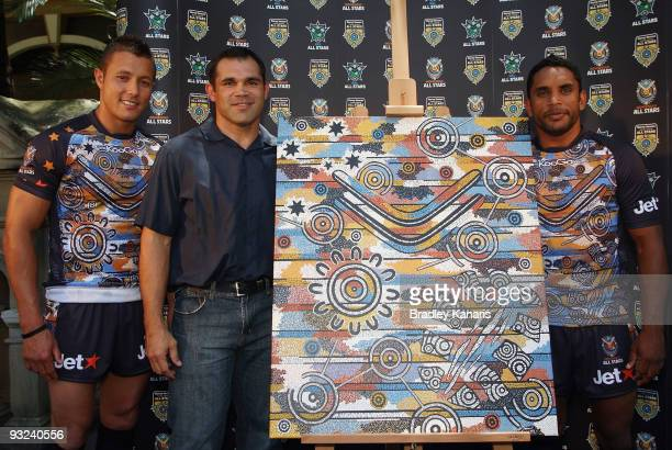Scott Prince and Preston Campbell pose with former NRL player and designer of the Indigenous team jersey Sid Domic after the announcement of the NRL...