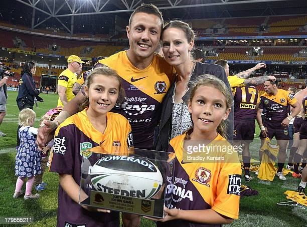 Scott Prince of the Broncos celebrates with his family after his 300th and final match of his career during the round 26 NRL match between the...