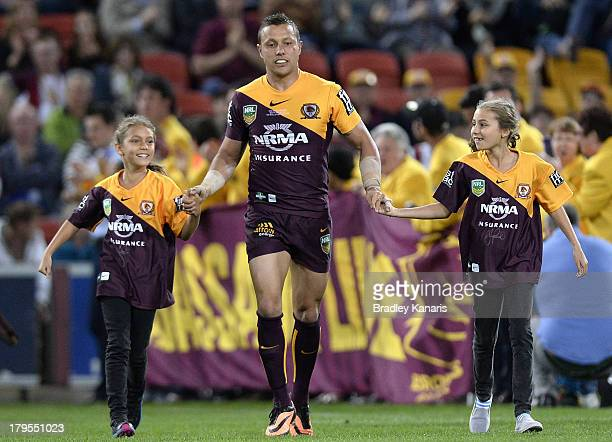 Scott Prince of the Broncos runs out for his final NRL match during the round 26 NRL match between the Brisbane Broncos and the Canterbury Bulldogs...