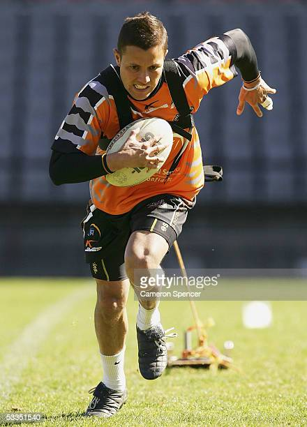 Scott Prince of the Tigers participates in a drill during a Wests Tigers training session at Concord Oval August 11 2005 in Sydney Australia