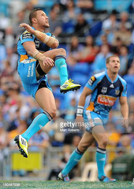 Scott Prince of the Titans kicks the ball during the round 24 NRL match between the Gold Coast Titans and the Parramatta Eels at Skilled Park on...