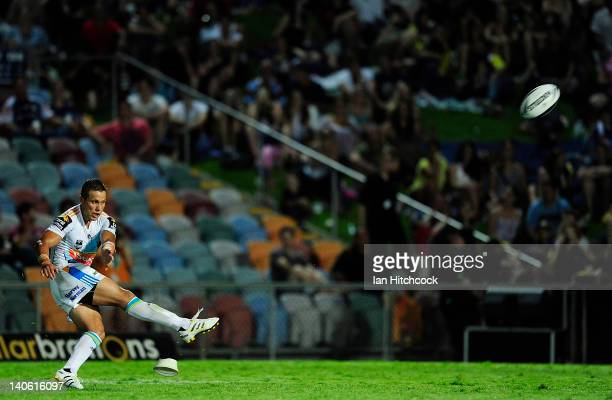 Scott Prince of the Titans kicks the ball during the round one NRL match between the North Queensland Cowboys and the Gold Coast Titans at Dairy...