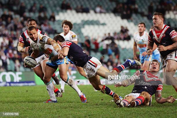 Scott Prince of the Titans looks for support close to the line during the round 21 NRL match between the Sydney Roosters and the Gold Coast Titans at...