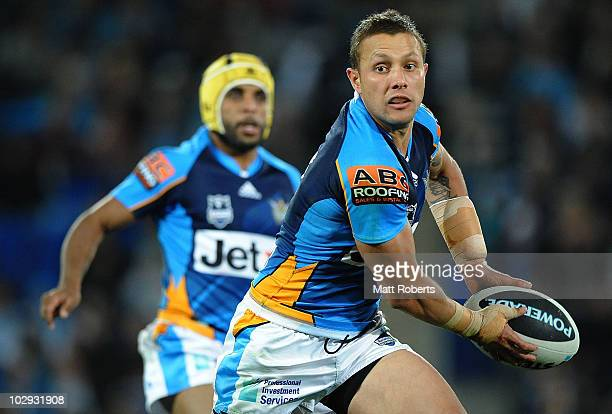 Scott Prince of the Titans looks to pass the ball during the round 19 NRL match between the Gold Coast Titans and the Brisbane Broncos at Skilled...