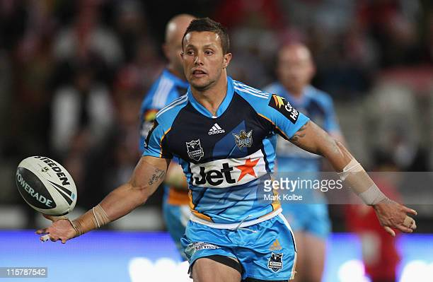 Scott Prince of the Titans passes during the round 14 NRL match between the St George Illawarra Dragons and the Gold Coast Titans at WIN Jubilee...