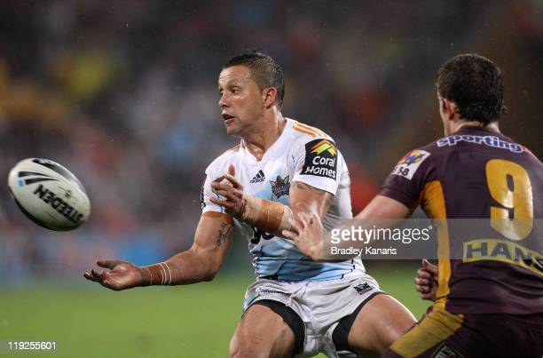 Scott Prince of the Titans passes the ball during the round 19 NRL match between the Brisbane Broncos and the Gold Coast Titans at Suncorp Stadium on...