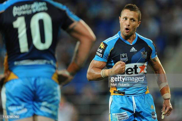 Scott Prince of the Titans speaks to his players during the round eight NRL match between the Gold Coast Titans and the Sydney Roosters at Skilled...