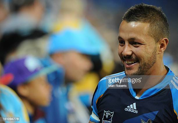 Scott Prince of the Titans thanks fans after the round 26 NRL match between the Gold Coast Titans and the Manly Sea Eagles at Skilled Park on...