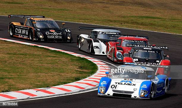 Scott Pruett and Memo Rojas drivers of the TELMEX Chip Ganassi Racing with Felix Sabates Lexus Riley leads a pack of cars during the Rolex Series...