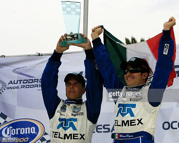 Scott Pruett and Memo Rojas drivers of the TELMEX Chip Ganassi with Felix Sabates Lexus Riley celebrate a second place finish in the DP class of the...
