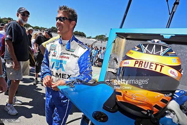 Scott Pruett driver of the BMW Riley talks with fans before the GrandAm Rolex Series race at Mazda Raceway Laguna Seca on September 8 2013 in...