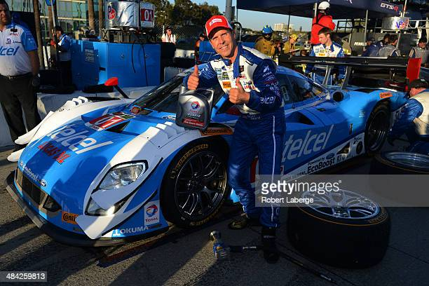 Scott Pruett driver of the Chip Ganassi Racing Riley DP Ford EcoBoost celebrates earning pole position for the Tudor United Sports Car Championship...
