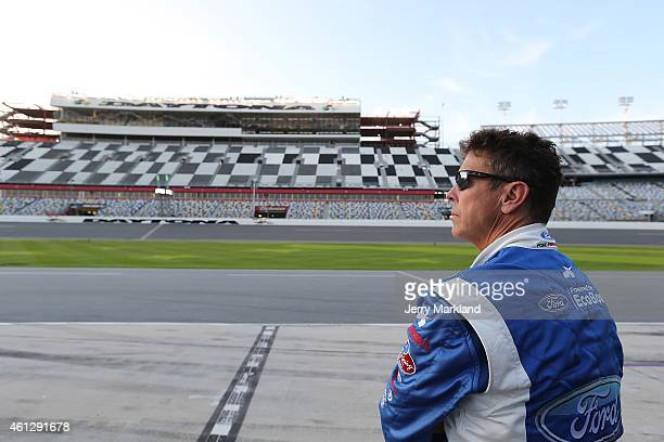 BEACH FL JANUARY Scott Pruett driver of the Chip Ganassi Racing with Felix Sabates Ford EcoBoost/Target Riley watches on during the ROAR Before the...