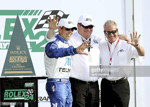 Scott Pruett driver of the Chip Ganassi with Felix Sabates BMW Riley poses with team owner Chip Ganassi and former chamion Hurley Haywood as five...