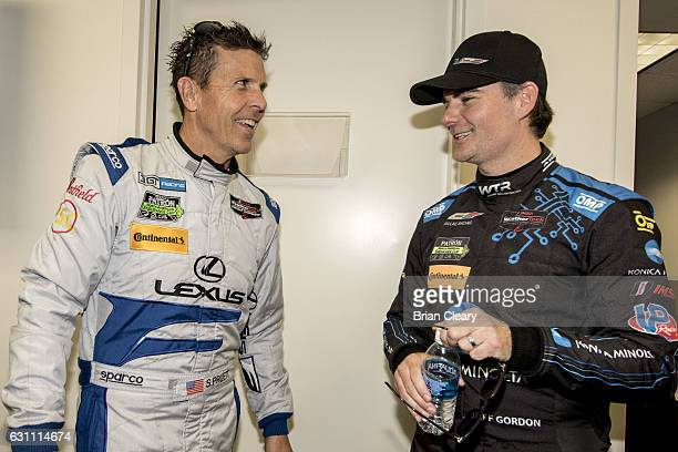 Scott Pruett L and Jeff Gordon share a laugh during a press conference during IMSA Roar Before the 24 testing at Daytona International Speedway on...