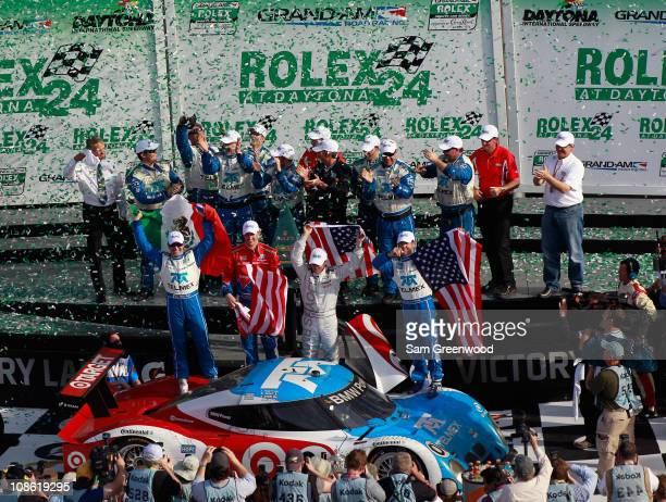Scott Pruett Memo Rojas Graham Rahal and Joey Hand drivers of the Target/TELEMEX BMW Riley celebrate winning the Rolex 24 at Daytona at Daytona...