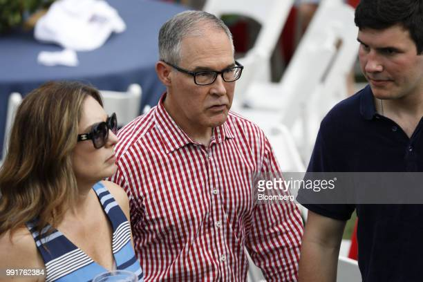 Scott Pruitt administrator of the Environmental Protection Agency center and his wife Marlyn Pruitt left attend a picnic for military families in...