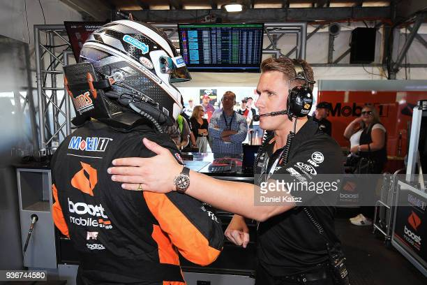 Scott Pye driver of the Mobil 1 Boost Mobile Racing Holden Commodore ZB is congratulated by Ryan Walkinshaw team owner of Walkinshaw Andretti United...