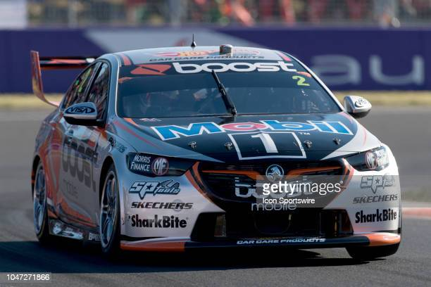 Scott Pye / Warren Luff in the Mobil 1 Boost Mobile Racing Holden Commodore head through turn one at the Supercheap Auto Bathurst 1000 V8 Supercar...