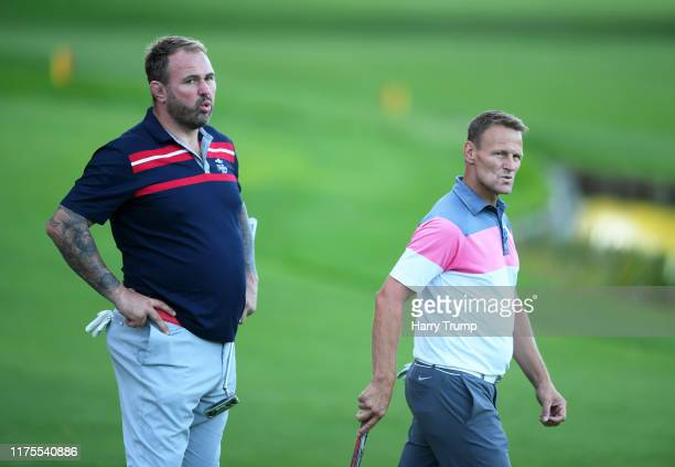 Scott Quinnell and Teddy Sheringham looks on during the BMW PGA Championship ProAm at Wentworth Golf Club on September 18 2019 in Virginia Water...