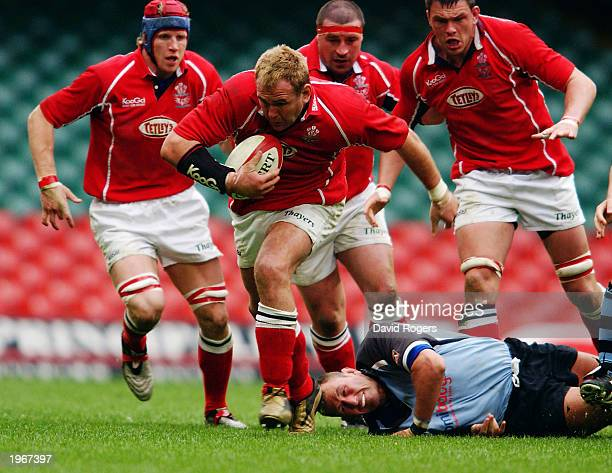 Scott Quinnell of Llanelli makes a break forward during the Principality Cup SemiFinal match between Cardiff and Llanelli held on April 19 2003 at...