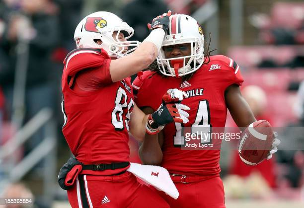Scott Radcliff and Andrell Smith of the Louisville Cardinals celebrate after Smith caught a touchdown pass during the game against the Temple Owls at...