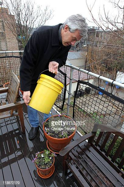 Scott Rappe works in his backyard and deck where he keeps recycling containers April 19 in Chicago Illinois In the yellow bucket are food scraps like...