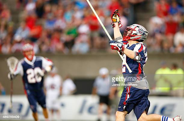Scott Ratliff of the Boston Cannons celebrates his goal in the first half against the Denver Outlaws at Harvard Stadium on May 10, 2014 in Boston,...
