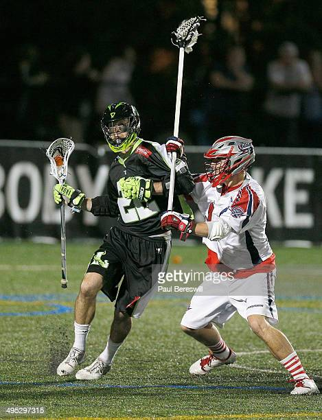 Scott Ratliff of the Boston Cannons checks Ned Crotty of the New York Lizards in the first half of a Major League Lacrosse game at James M. Shuart...
