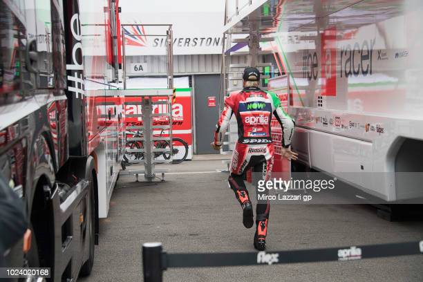 Scott Redding of Great Britain and Aprilia Racing Team Gresini prepares to start and make strech between the trucks during the MotoGP race during the...