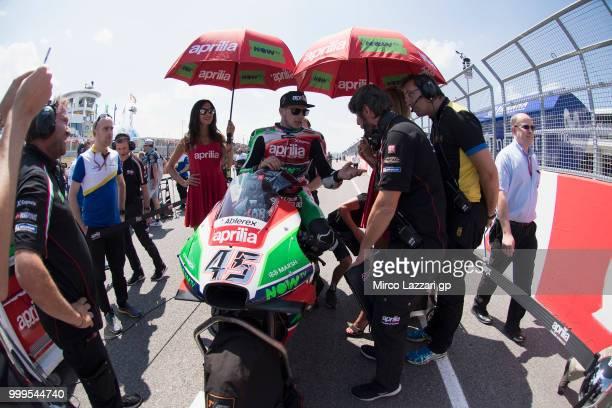 Scott Redding of Great Britain and Aprilia Racing Team Gresini prepares to start on the grid during the MotoGP race during the MotoGp of Germany Race...