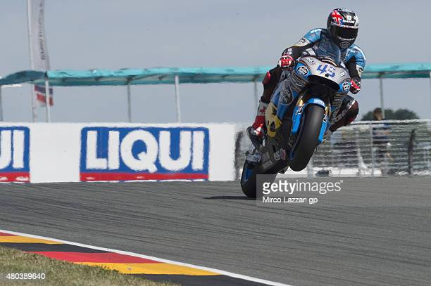 Scott Redding of Great Britain and Estrella Galicia 00 Marc VDS lifts the front wheel during the MotoGp of Germany Qualifying at Sachsenring Circuit...
