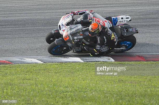 Scott Redding of Great Britain and Octo Pramac Racing and Esteve Rabat of Spain and Estrella Galicia 00 Marc VDS during the MotoGP Tests In Sepang at...