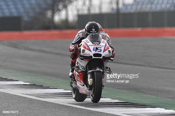 Scott Redding of Great Britain and Octo Pramac Racing heads down a straight during the MotoGp Of Great Britain qualifying practice at Silverstone...