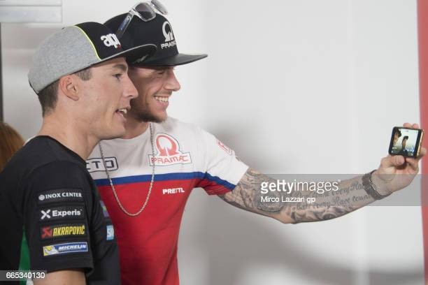 Scott Redding of Great Britain and Octo Pramac Racing makes a selfie with Aleix Espargaro of Spain and Team Suzuki ECSTAR during the MotoGp of...