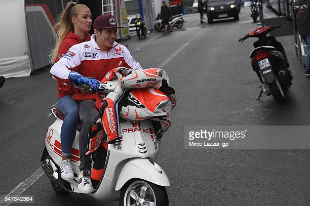 Scott Redding of Great Britain and Octo Pramac Racing rides the scooter in paddock during the MotoGp of Germany Preview at Sachsenring Circuit on...