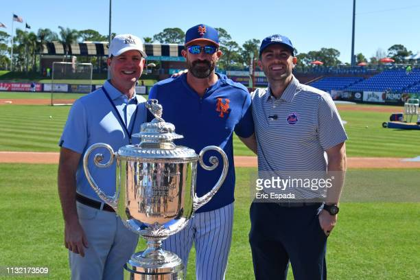 Scott Reid of the PGA poses with New York Mets manager Mickey Calloway and David Wright behind the PGA Championship Trophy before the start of the...