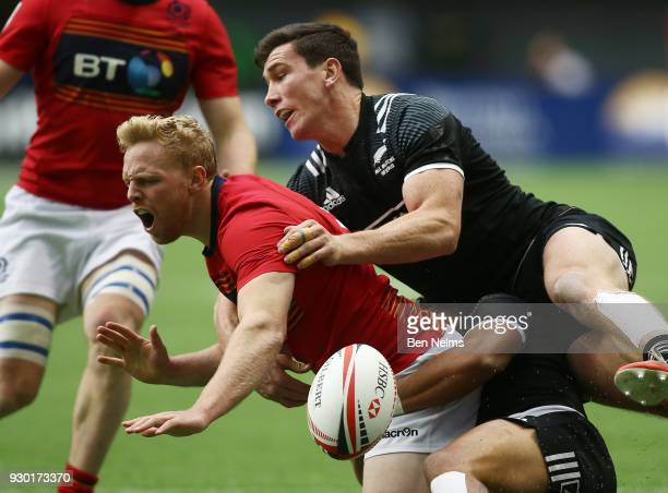 Scott Riddell of Scotland is tackled by Regan Ware of New Zealand during the Canada Sevens the Sixth round of the HSBC Sevens World Series at the BC...